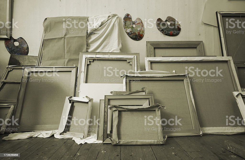 Paintings turned against the wall stock photo