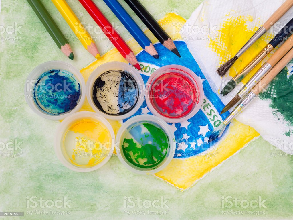 Paints lids,brushes, pencils  the brazil flag painting stock photo
