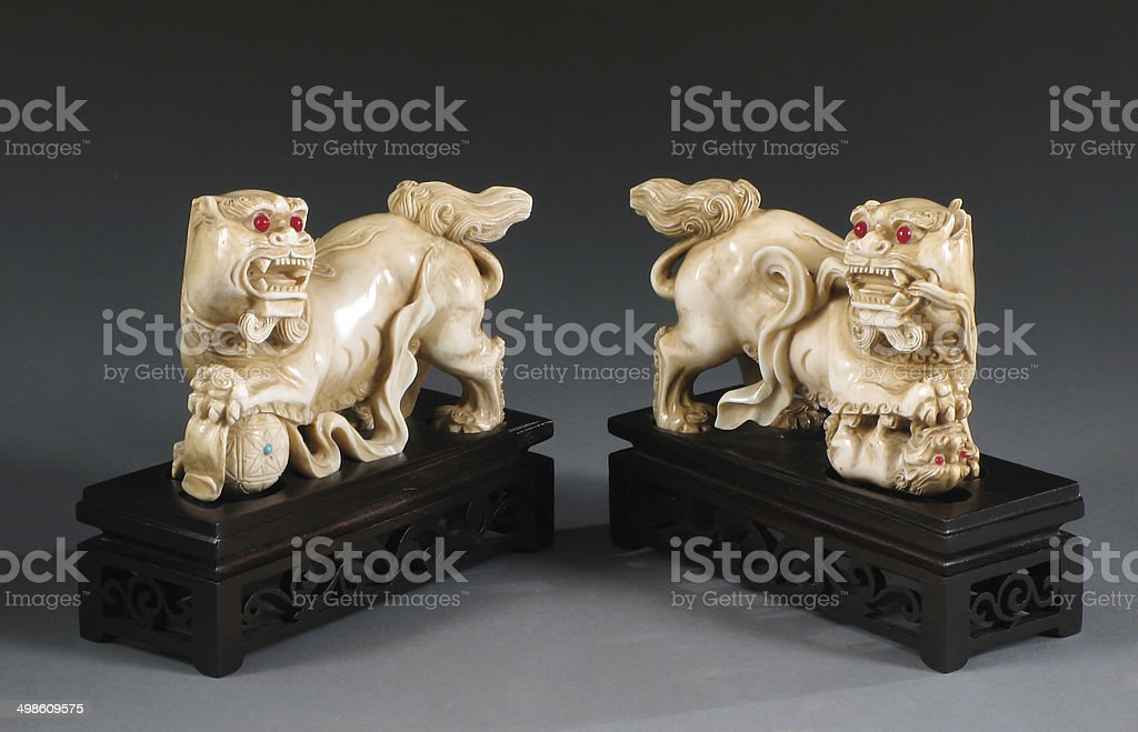 Pair Chinese Ivory Foo Lions stock photo