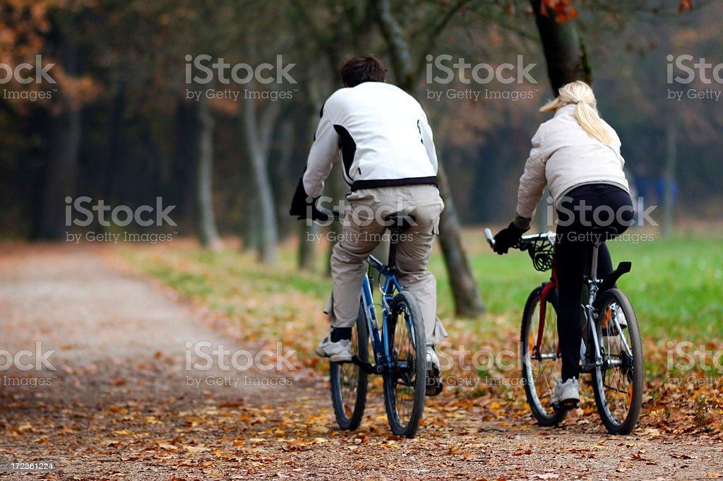 Pair cycling stock photo