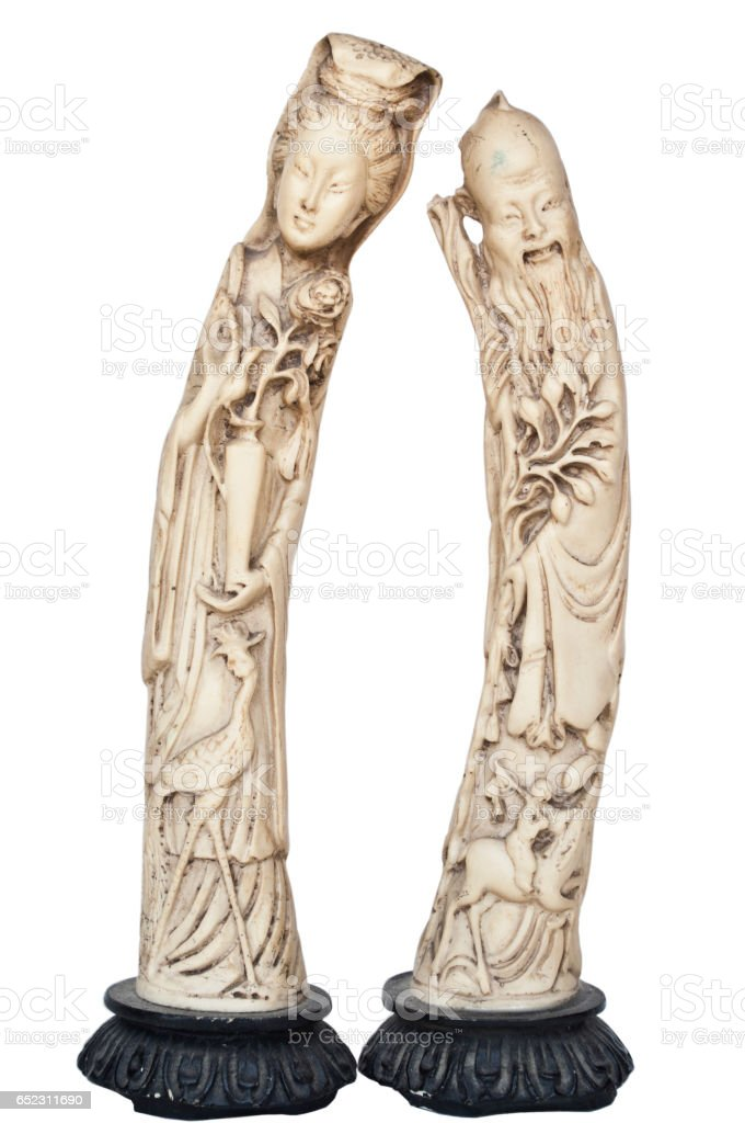 Pair mof Asian statues isolated on white stock photo