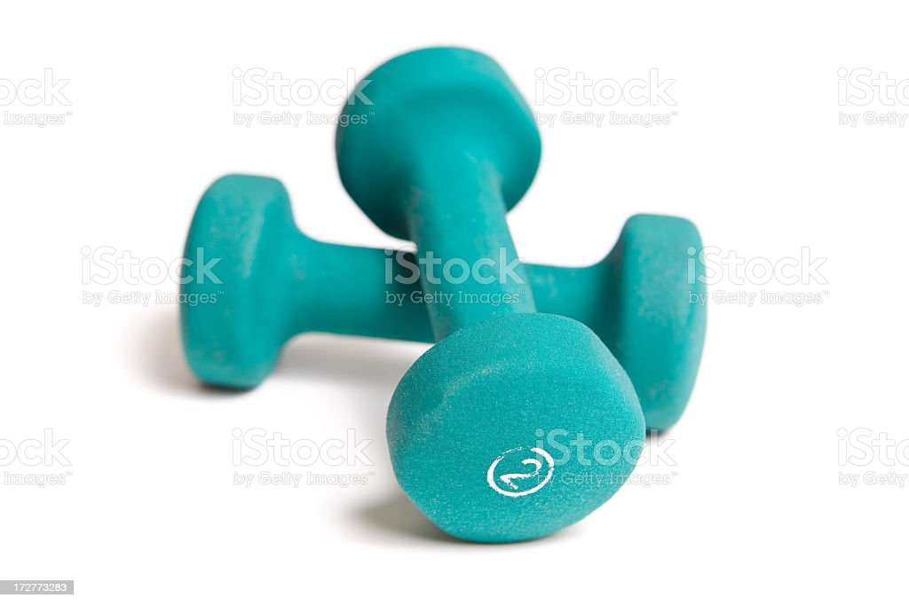 A pair of 2-lb green dumbbells on white background royalty-free stock photo