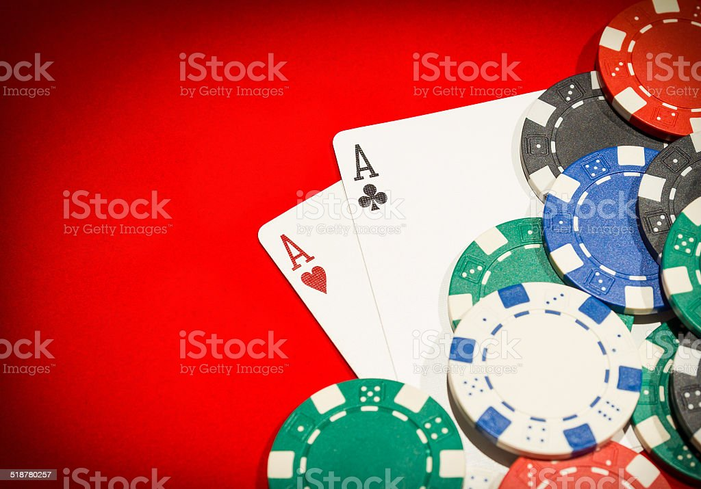 Pair of aces and chips on a red table stock photo