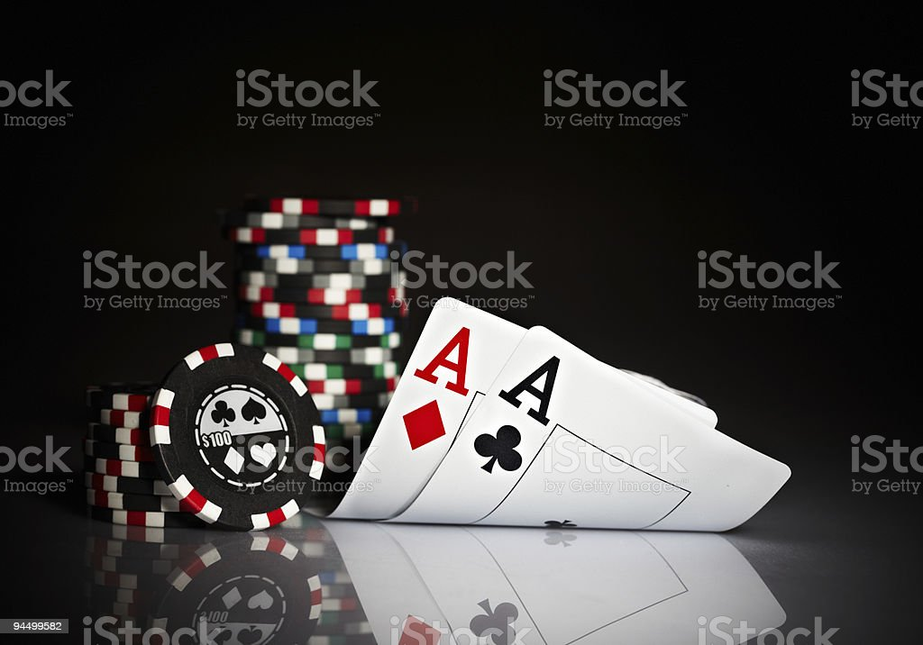 A pair of Aces and poker chips stock photo
