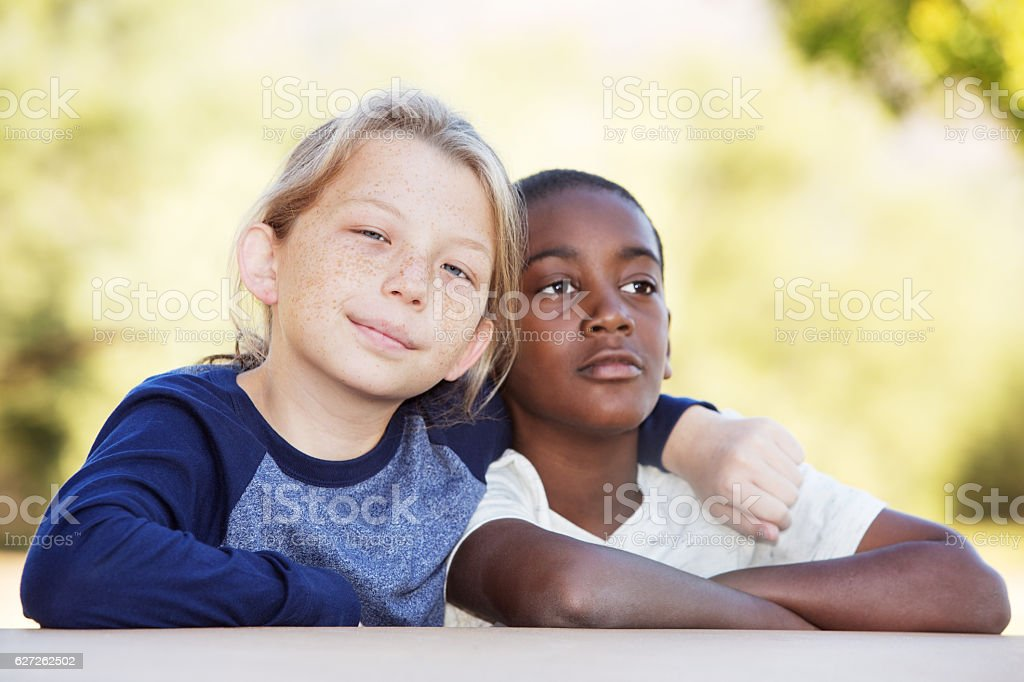 Pair of adopted brothers together stock photo