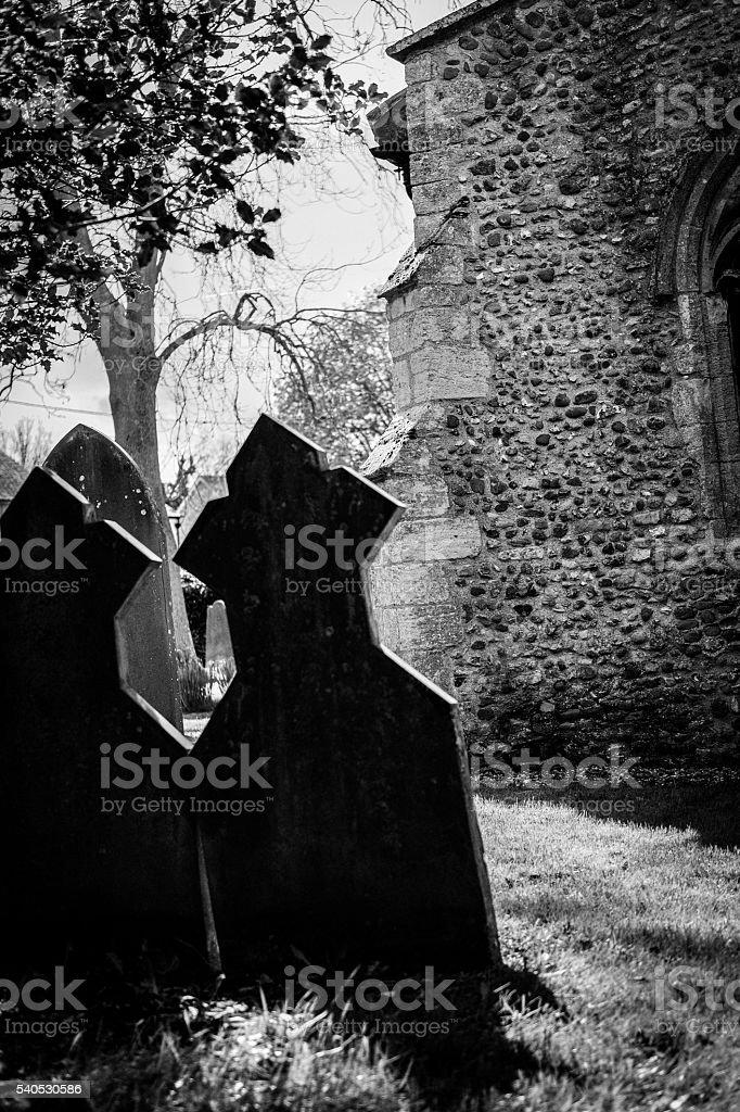 Pair of ancient gravestones producing a menacing scene stock photo