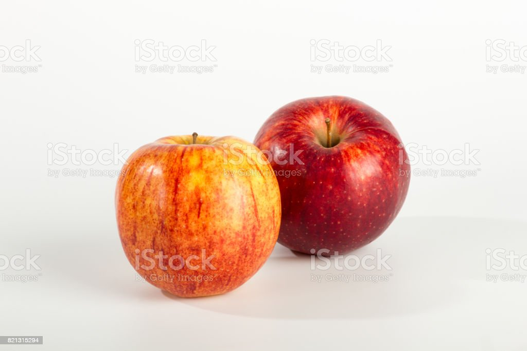 A Pair of Apples on Plain White Background stock photo