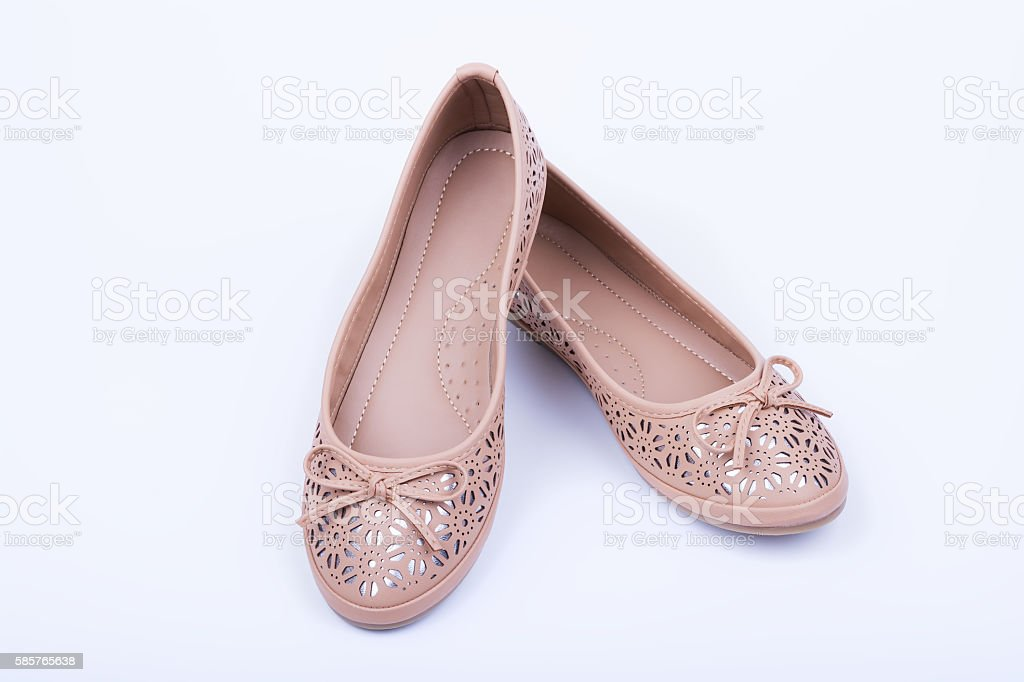 Pair of beige female shoes on white background stock photo