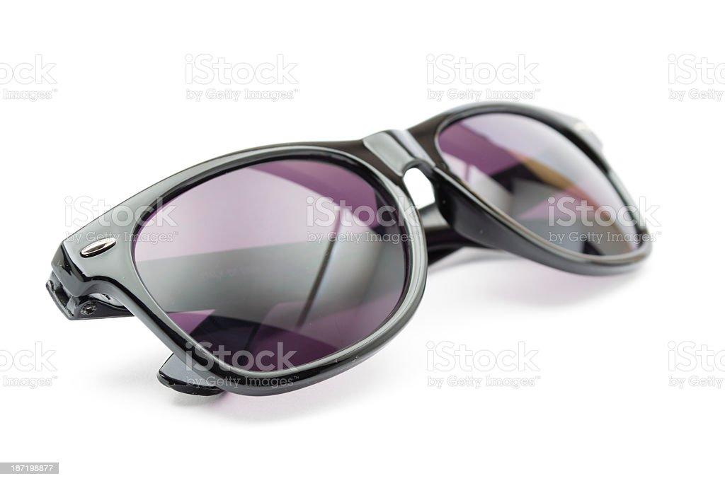 Pair of black and purple sunglasses stock photo