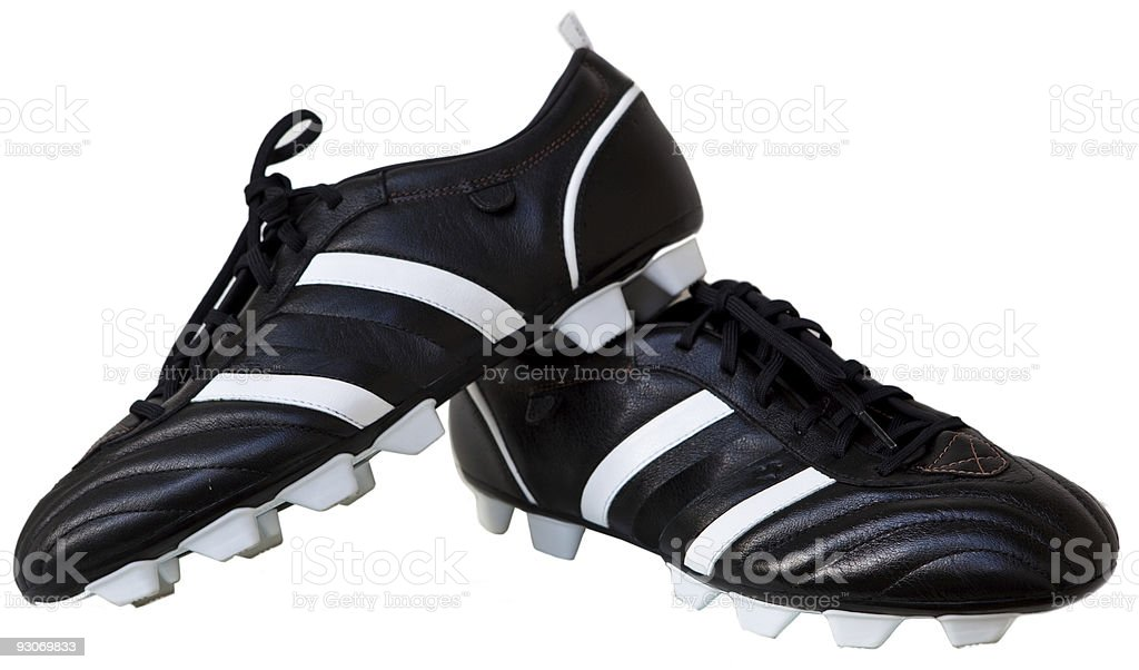 A pair of black and white soccer cleats  stock photo
