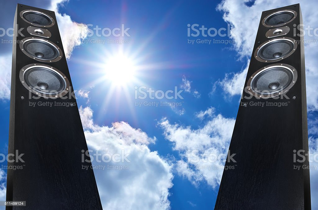 Pair of black music speakers on deep blue sky background stock photo