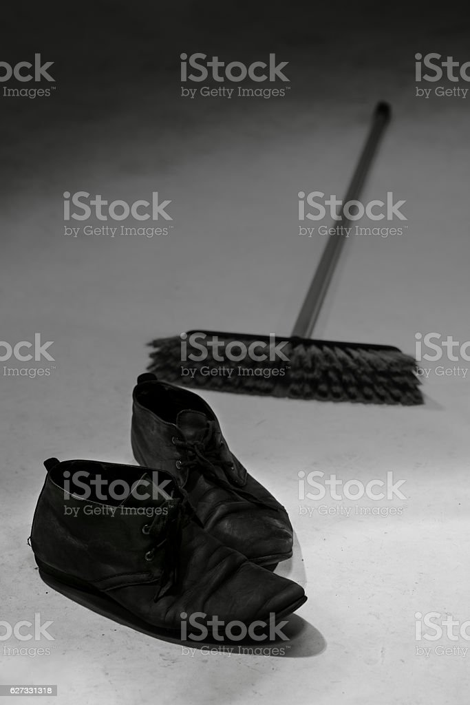 Pair of black shoes and brush stock photo