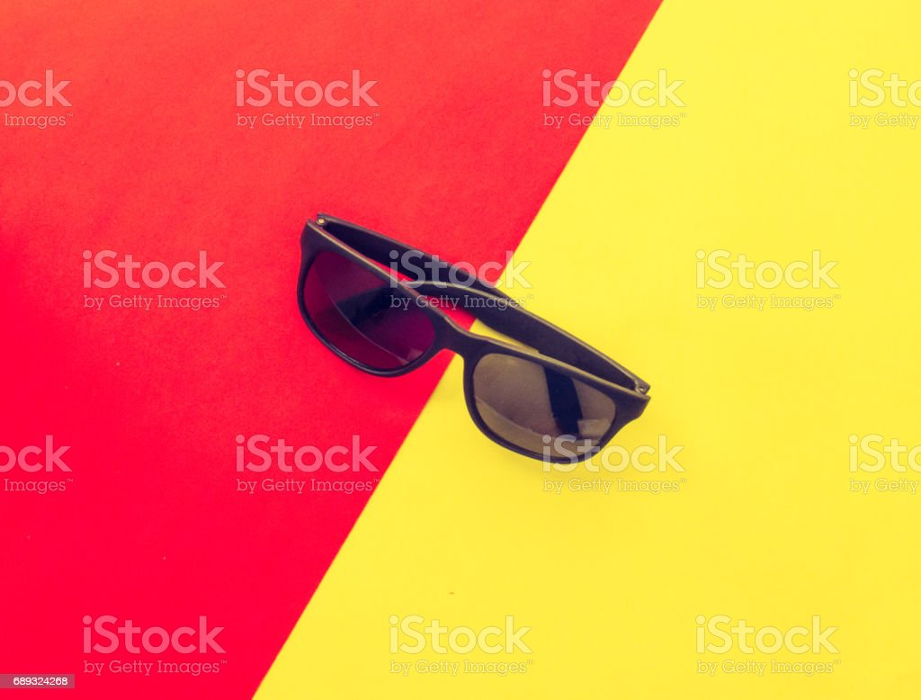 A pair of black sunglasses on a colorful pastel background. stock photo