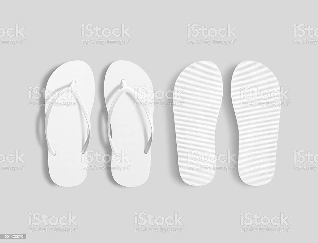 Pair of blank white beach slippers mockup, top sole view stock photo