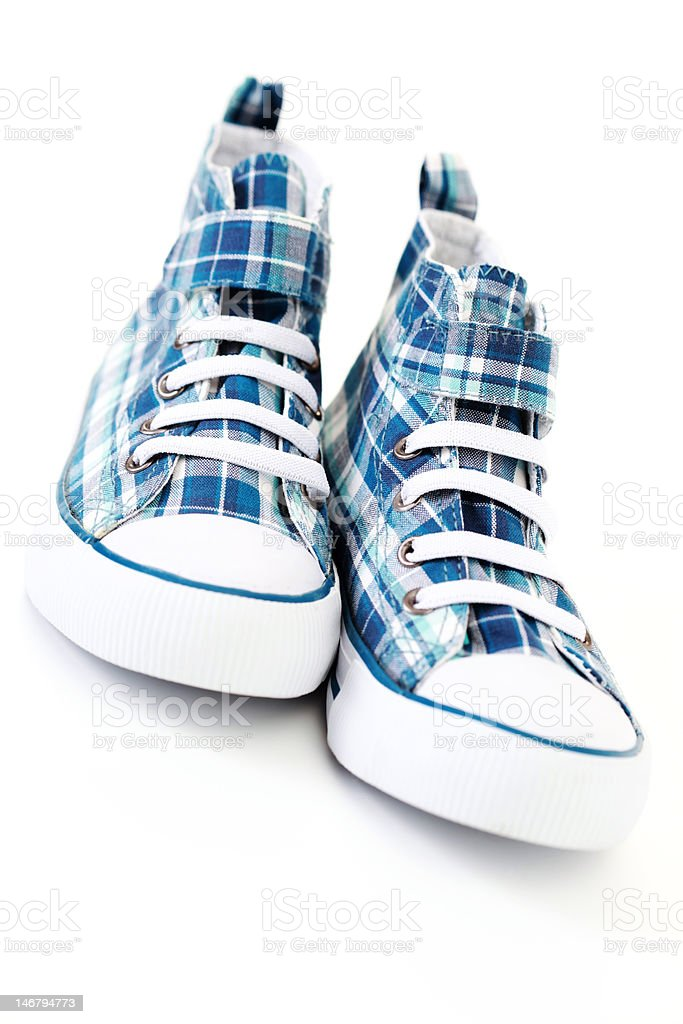 pair of blue sneakers royalty-free stock photo