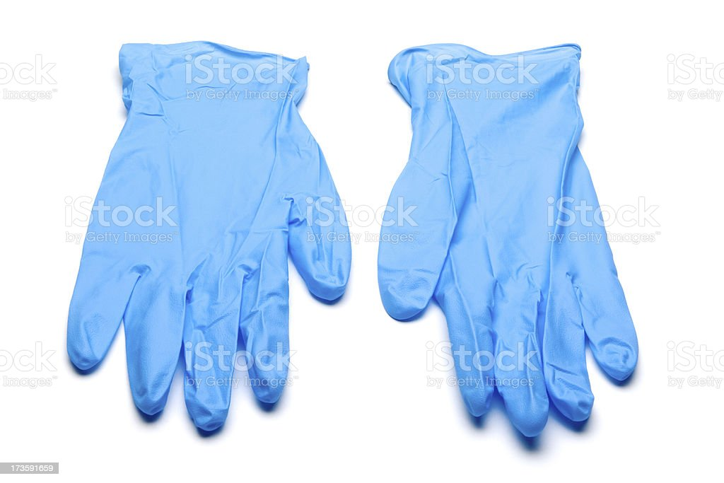 Pair of blue surgical gloves against white background stock photo