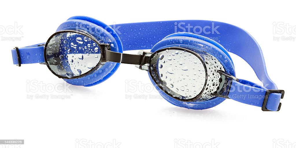 Pair of blue wet swimming goggles stock photo