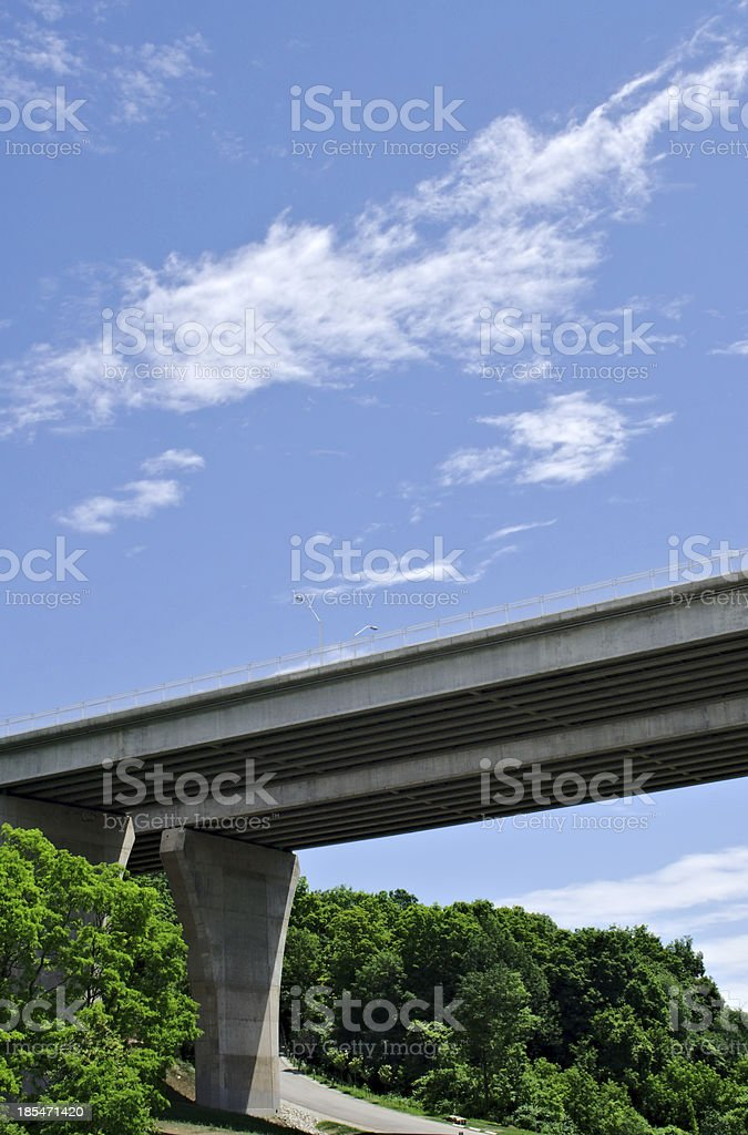 Pair of bridges crossing forest on sky royalty-free stock photo