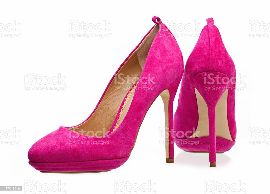 Pair of bright pink women's high heels isolated on white royalty-free stock photo