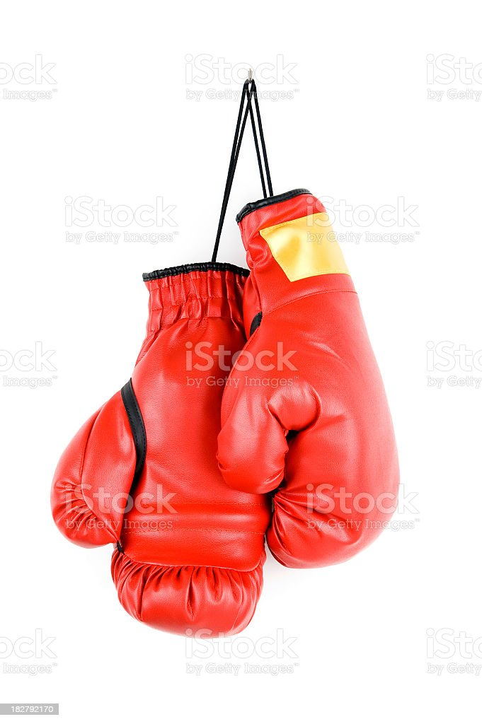 Pair of bright red boxing gloves hanging up stock photo