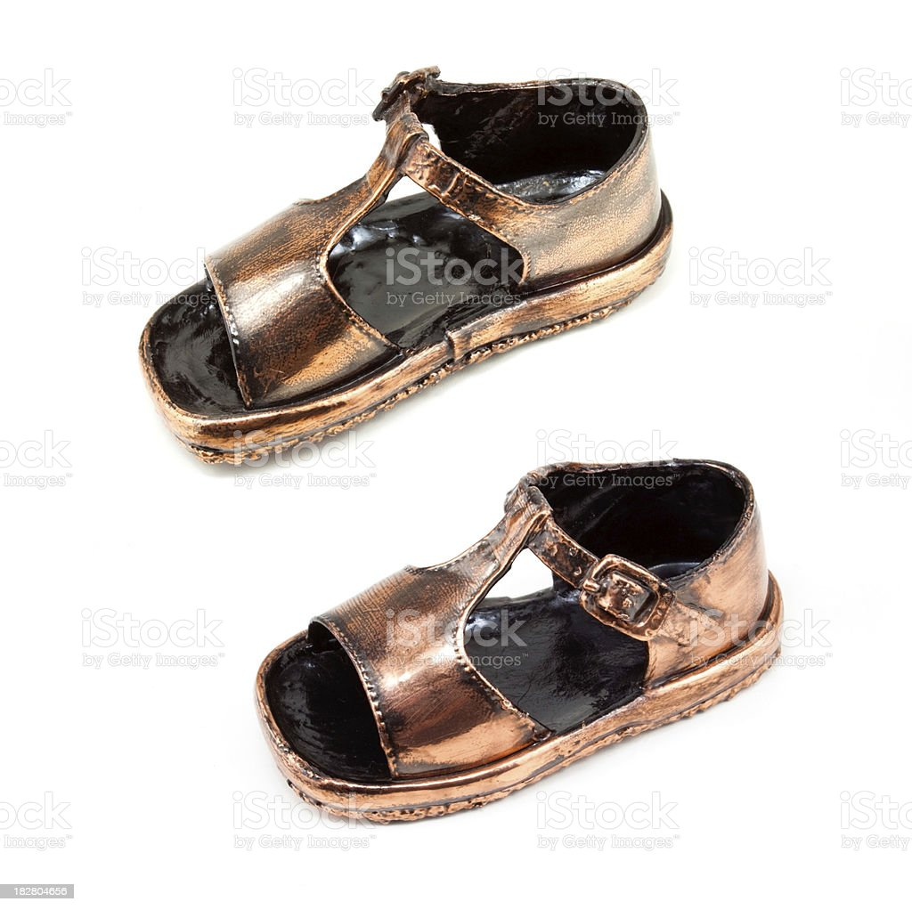 Pair of Bronzed Baby shoes stock photo