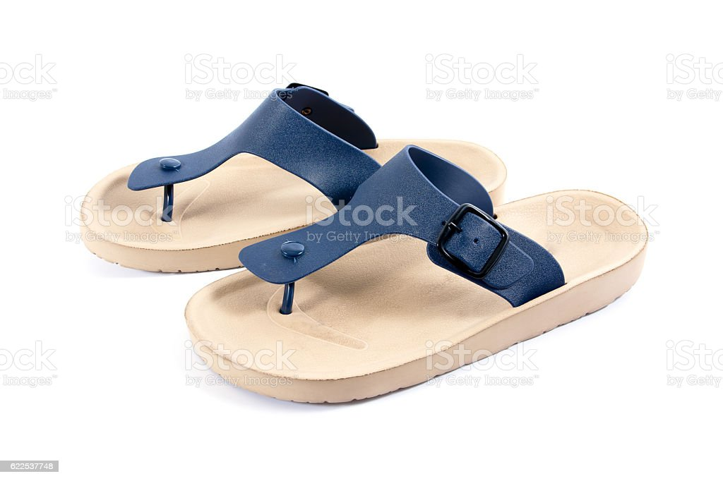 Pair of brown men's flip flop sandals isolated on white stock photo