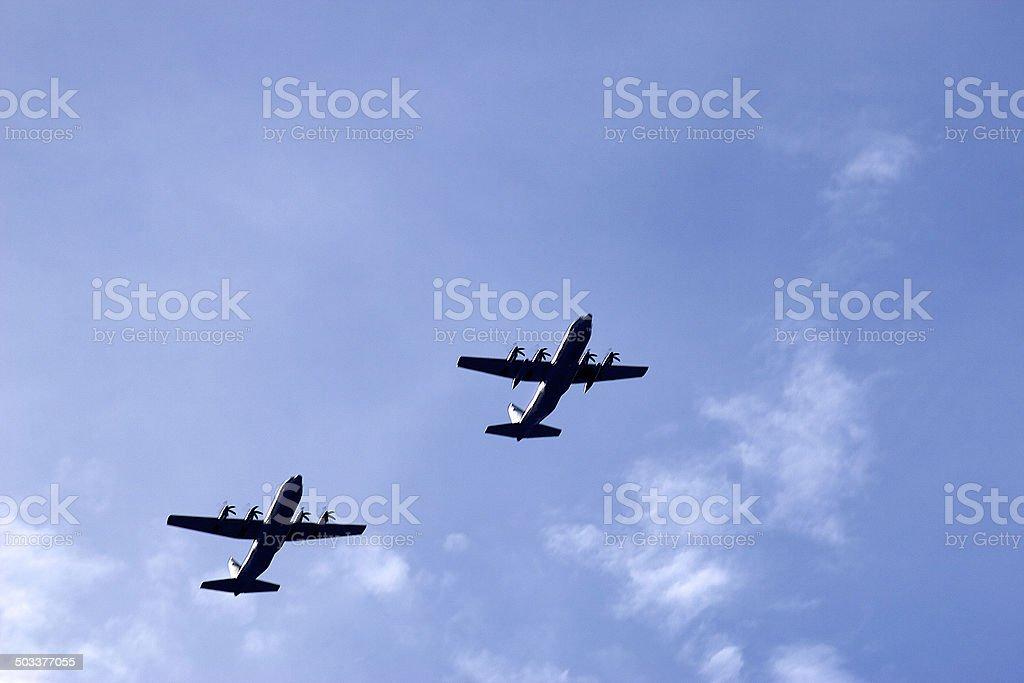 Pair of C-130 Hercules military transport aircraft stock photo