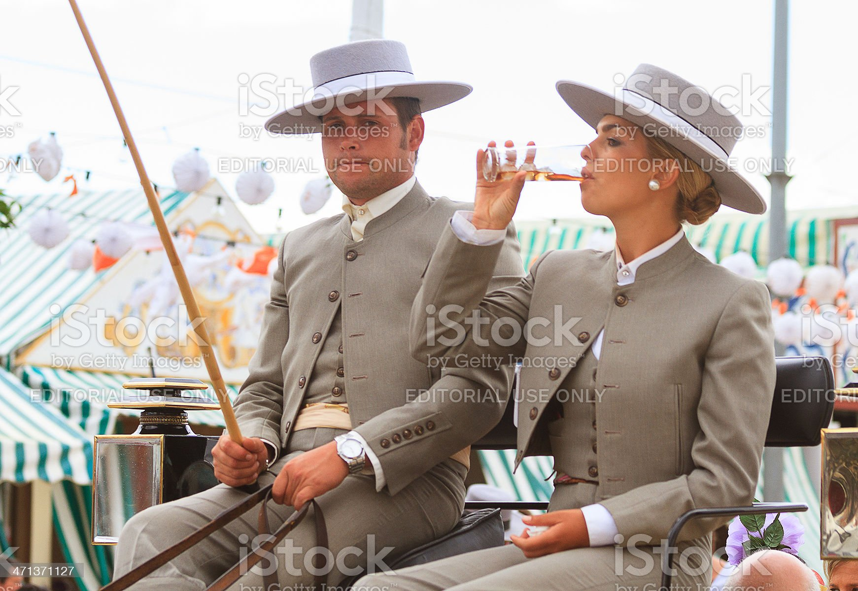 pair of carriage conductors in the Seville April Fair royalty-free stock photo