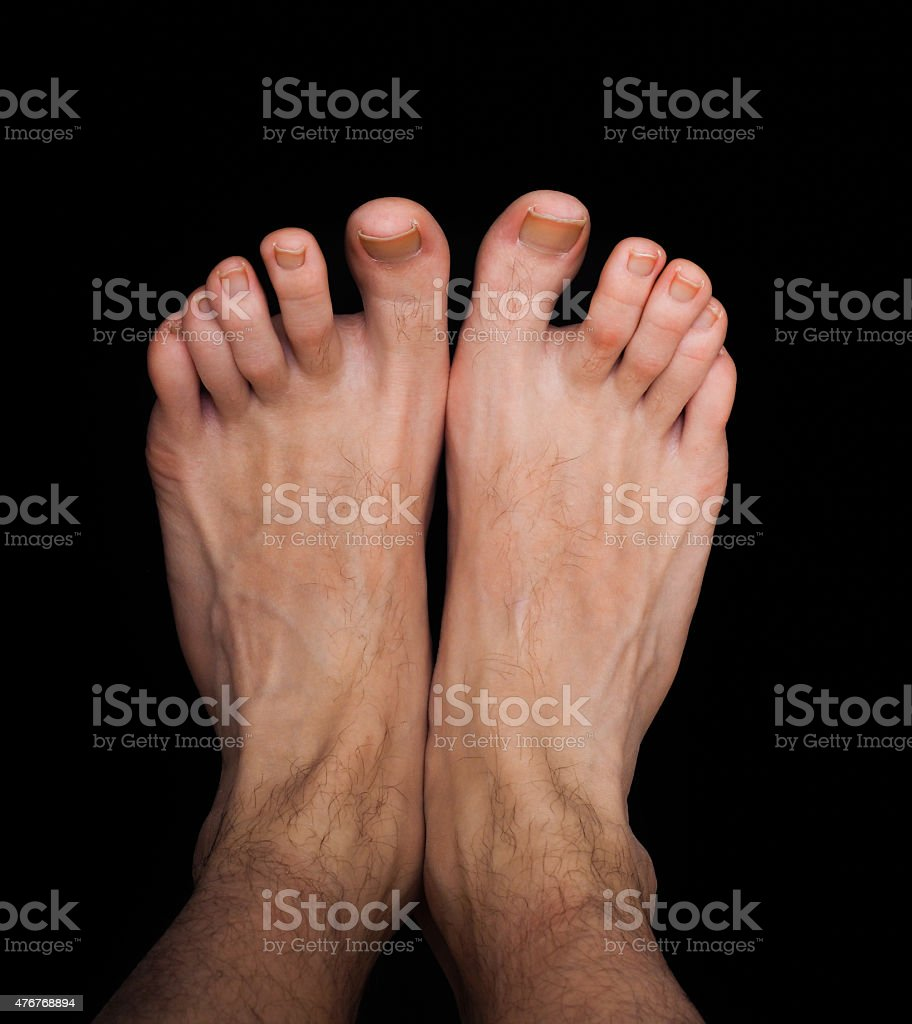 Pair of caucasian male feet isolated stock photo