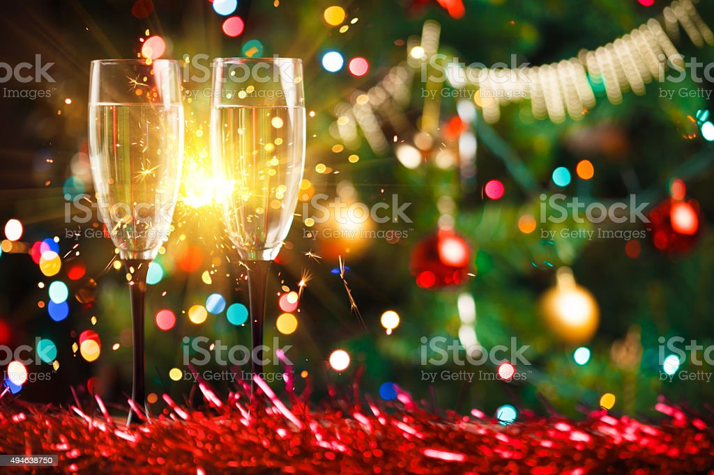 pair of champagne glasses and sparkler stock photo