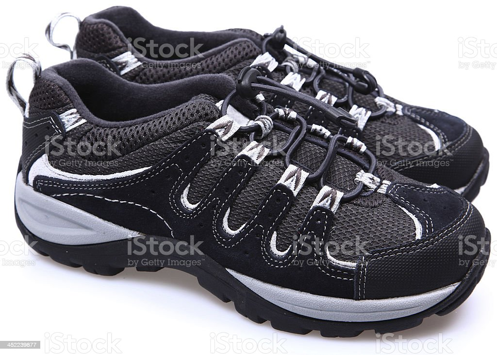 Pair of child's hiking tennis shoes. stock photo