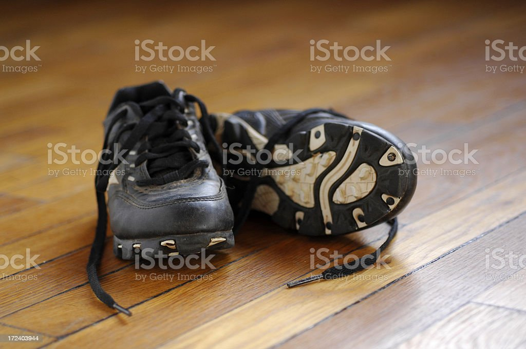 Pair of cleats on a wooden floor royalty-free stock photo