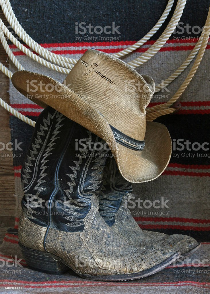 A pair of cowboy boots and a cowboy hat royalty-free stock photo