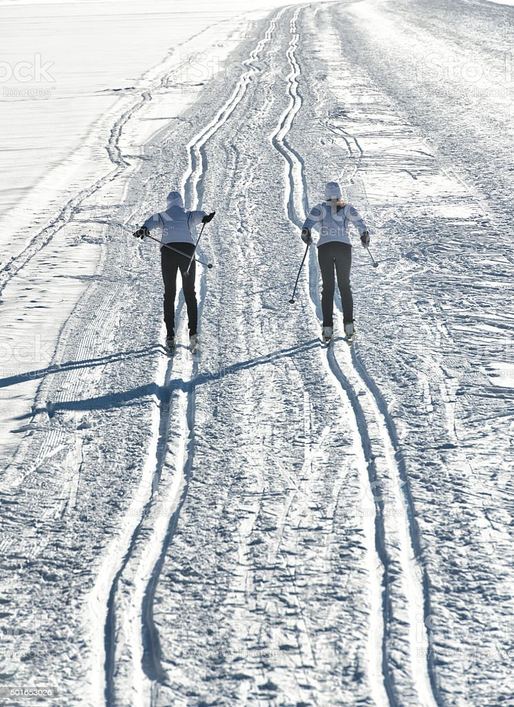 Pair of cross-country skiers stock photo