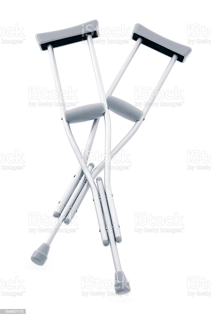 Pair of crutches against white background royalty-free stock photo