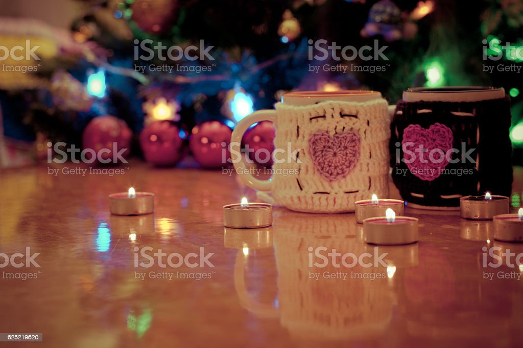 pair of cups of tea on the table against stock photo