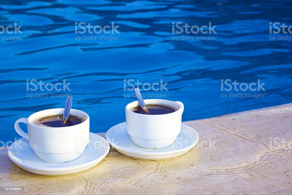 pair of cups on the poolside royalty-free stock photo