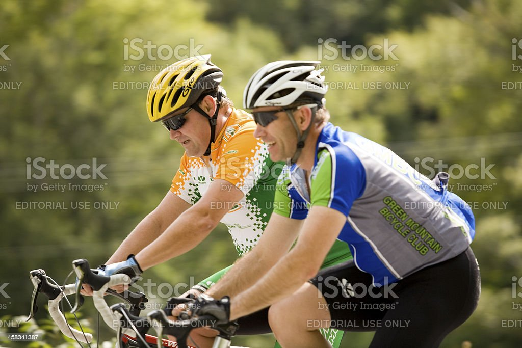 Pair of Cyclists Ringing Together stock photo