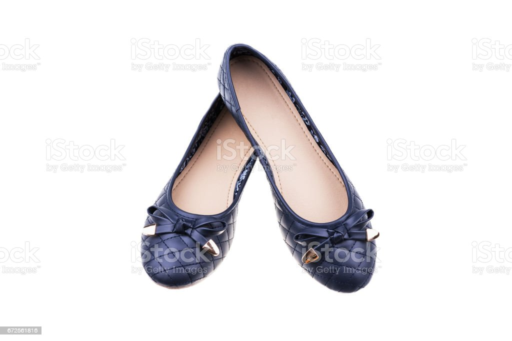 Pair of dark blue ladies' flat shoes isolated on white. stock photo