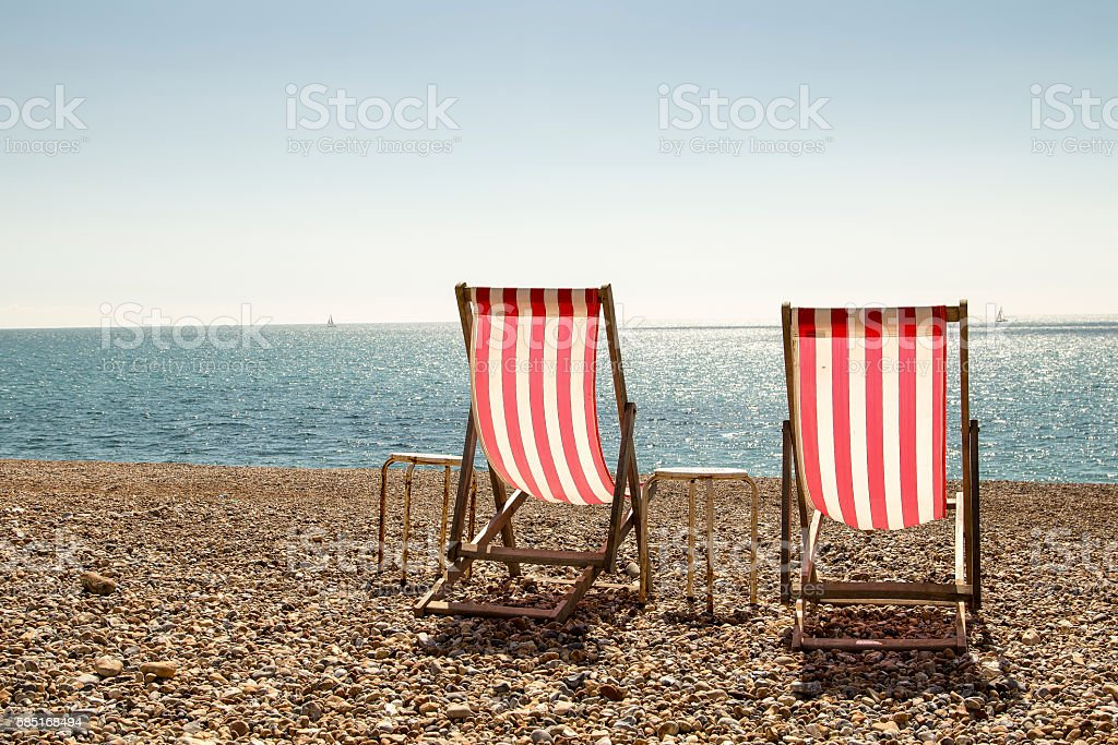 Pair of deckchairs stock photo