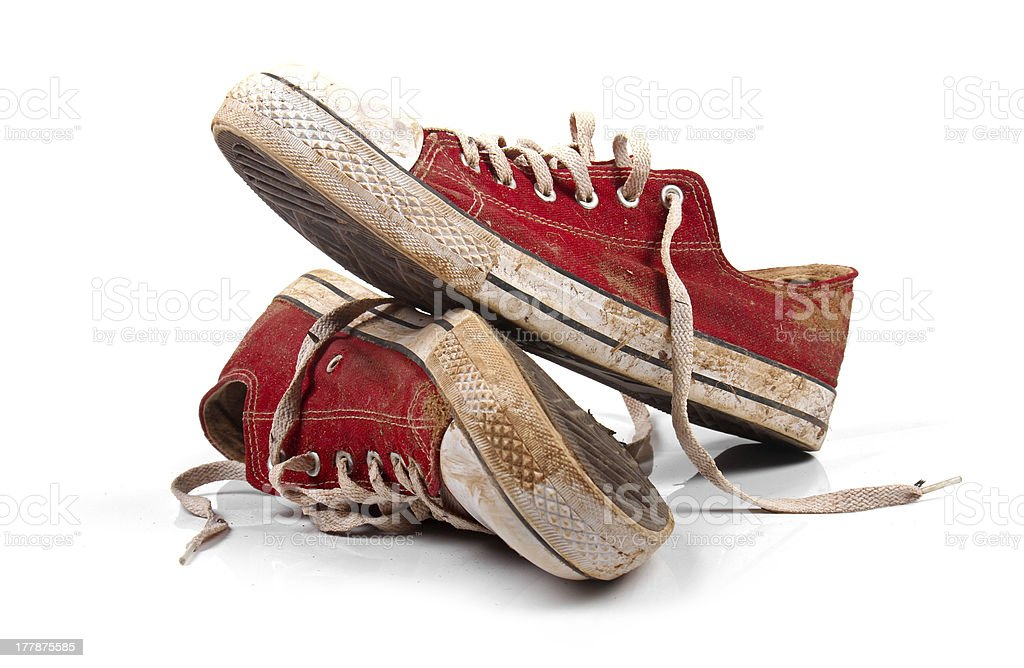 pair of dirty sneakers isolated on white stock photo