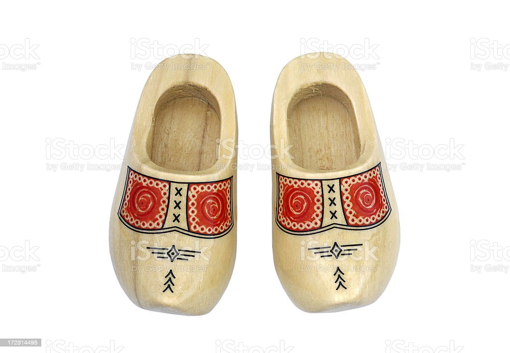 Pair of Dutch miniature wooden shoes, handmade and hand-painted, isolated stock photo