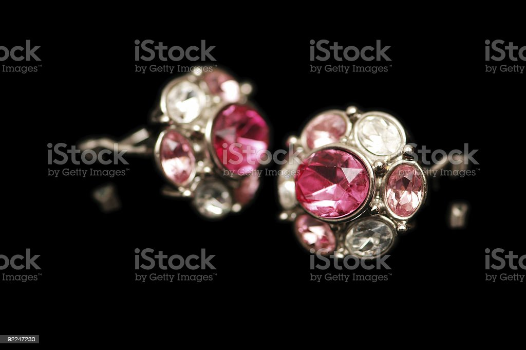 Pair of earrings isolated on the black royalty-free stock photo