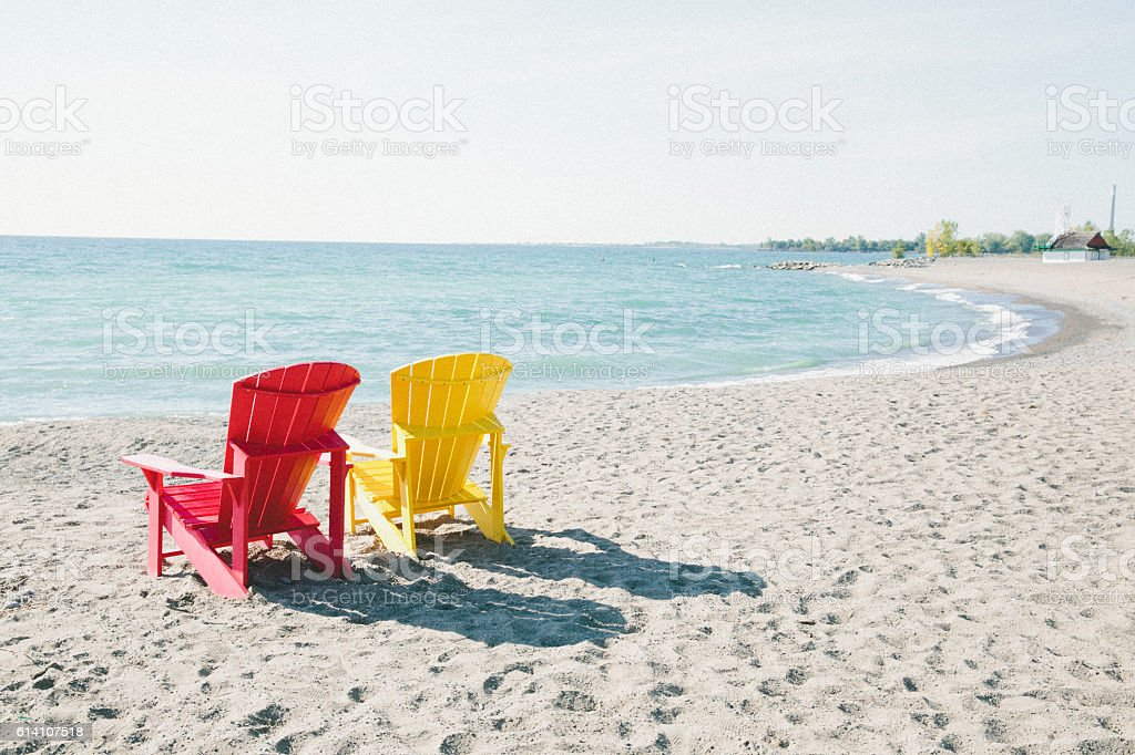 Pair of empty seats on the beach stock photo
