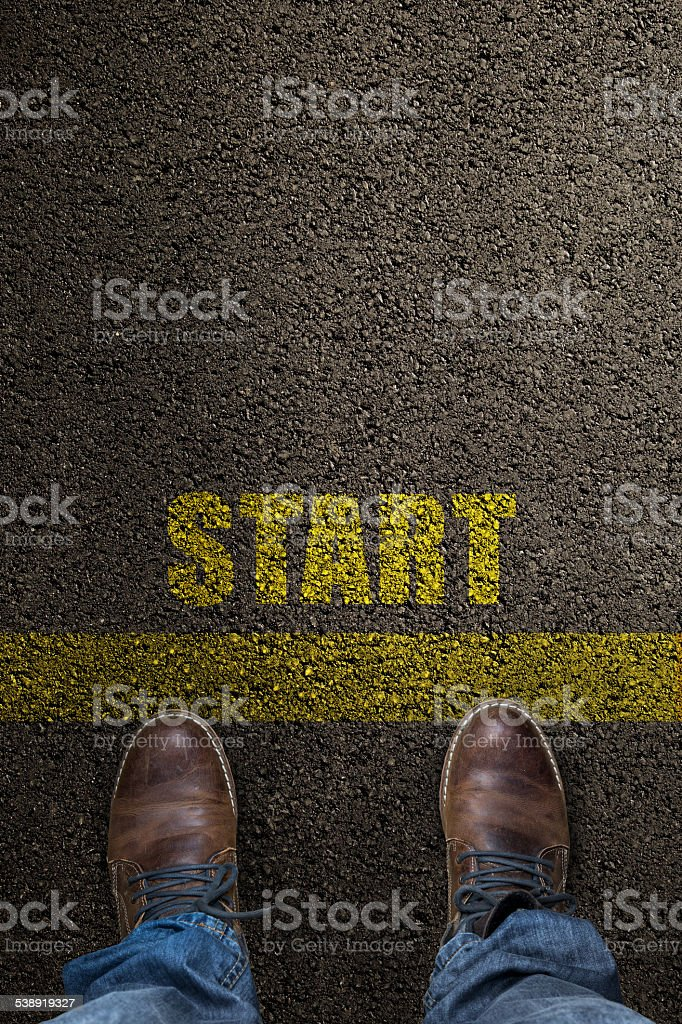 pair of feet on a tarmac road stock photo