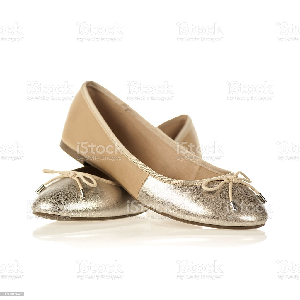 Pair of Flats in the fashionable colors nude and metallic royalty-free stock photo