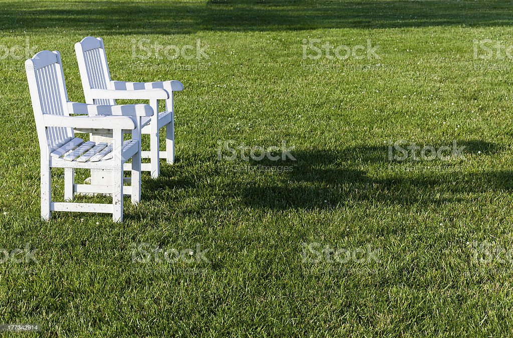 Pair of garden chairs on green lawn royalty-free stock photo