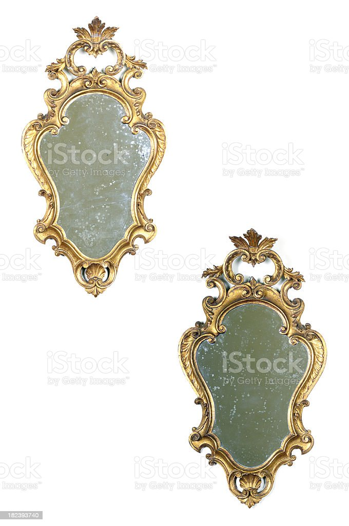 Pair of Gold Ancient Mirrors royalty-free stock photo
