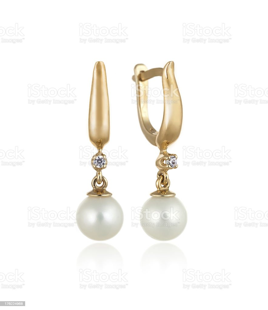 Pair of Gold Earrings with Diamonds and Pearls / Isolated stock photo