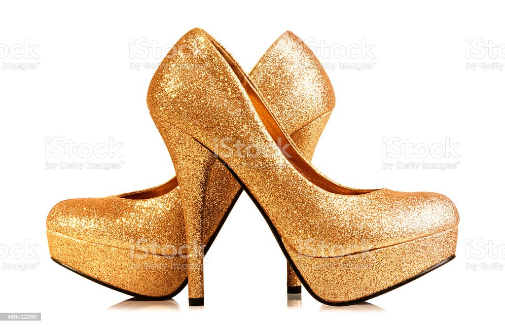 Pair of gold heels isolated on white. With Clipping path. stock photo